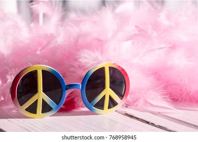 Peace sign sunglasses and pink feather boa