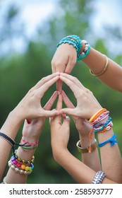 peace sign or symbol made with hands by group of youth