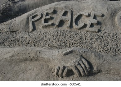 Peace spelled out in the sand.