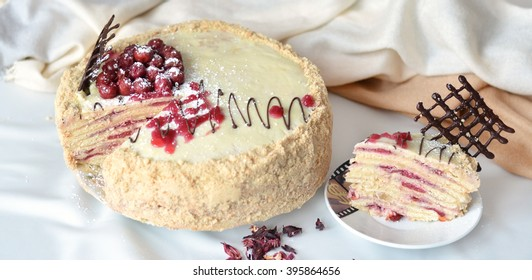 Peace of tasty cherry cake on a plate