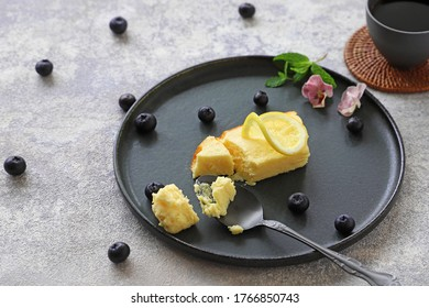 Peace of white chocolate cheese terrine with blueberries  on black plate