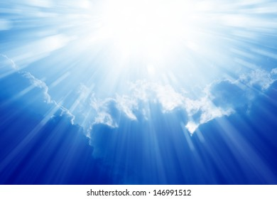 Peaceful background - beautiful blue sky with bright sun, light from heaven