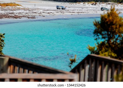Peaceful bay, mid morning on a summers day, 4WD vehicles on the beach. Main beach at Bremer Bay southern coast, east of Albany Western Australia.