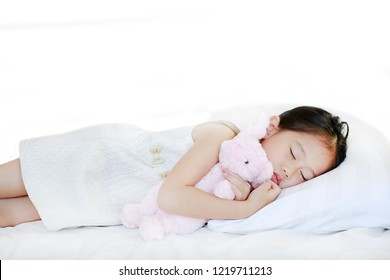 Peaceful beautiful Asian child girl sleeping on bed.