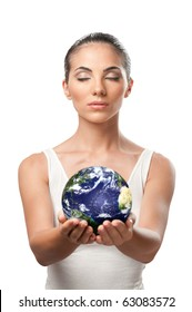 Peaceful beautiful woman holding planet earth with care and responsibility, symbol of environment protection