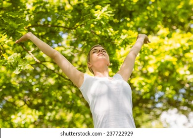 Peaceful blonde enjoying the sunshine on a sunny day