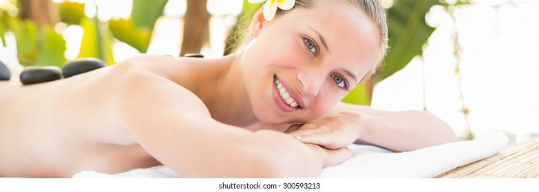 Peaceful blonde lying on towel at the health spa