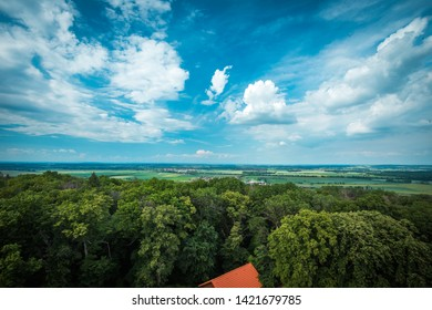 Peaceful blue cloudy sky and forrest. Blue sky and trees. Clear blue sky with white Clouds Exhale wallpaper background and background