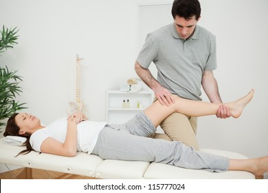 Peaceful brunette woman lying on a medical table in a physio room