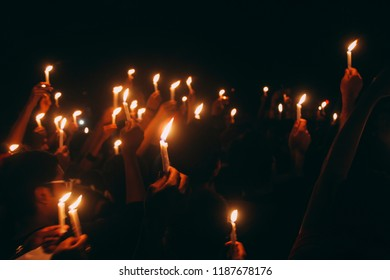 a peaceful candlelight procession