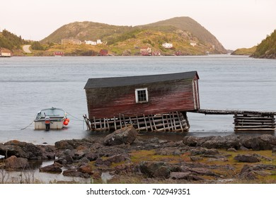Peaceful cove in Newfoundland, NL, Canada, surrounded by fishing shacks and outport houses