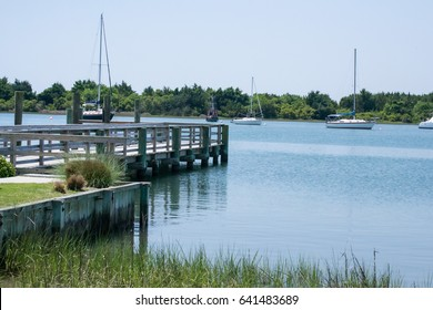 Peaceful fishing dock in Beaufort North Carolina with Carrot Island in the distance where wild horses roam - vacation destinations in eastern north carolina