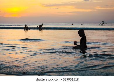 Peaceful golden sunset on the beach at Jimbaran beach, Indonesia