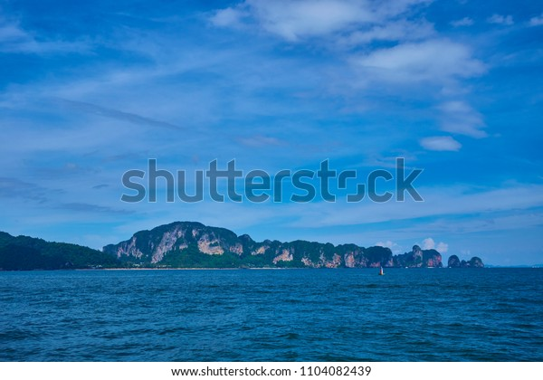 Peaceful island with beautiful sky in Andaman ocean, Krabi, Thailand.