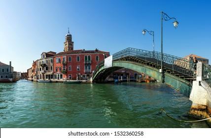 The peaceful island of Murano, near Venice in Italy. The green metal bridge of Ponte Longo.