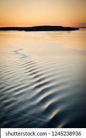 Peaceful Lake with Ripple at Sunrise