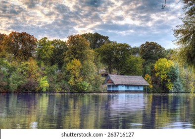 Peaceful lake view with old cabin on Herastrau lake in Bucharest, Romania