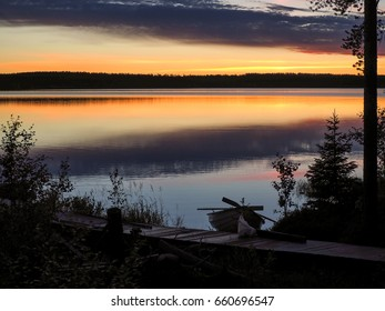 A peaceful lake view at sunset from Suomussalmi, Finland.