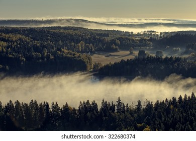 Peaceful landscape of Aulanko nature reserve park in Finland. Thick fog covering the scenery in the early morning. HDR image.