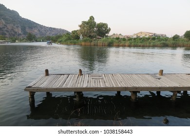 Peaceful landscape consisting of a wooden pier
