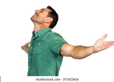 Peaceful man with closed eyes and arms outstretched on white screen