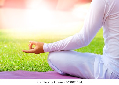Peaceful Meditation in morning sunny day for good health.in soft light
