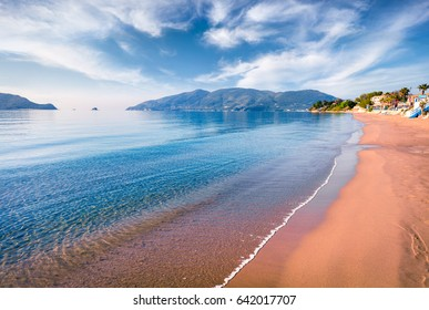 Peaceful morning view of beach of Zakynthos (Zante) island. Sunny spring seascape of the Ionian Sea, Greece, Europe. Beauty of nature concept background.