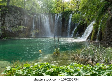 Peaceful panorama of waterfalls in the midst of the forest in Plitvice Lakes National Park in Croatia