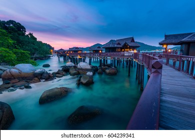 Peaceful and quiet sunset view of the ocean with wooden houses on stilts at the Straits of Malacca