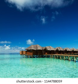 Peaceful and relaxing on the sea. Happy island lifestyle. Crystal-blue sea of tropical beach. Vacation at Paradise. Ocean beach relax, travel to Maldives islands