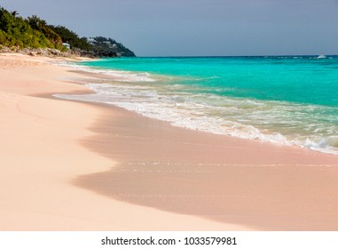 Peaceful, relaxing scene with pink sand and turquoise ocean at Long Bay Beach on the South Shore in Warwick, Bermuda.