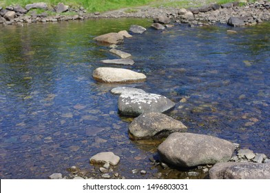 Peaceful river crossing - stepping stones