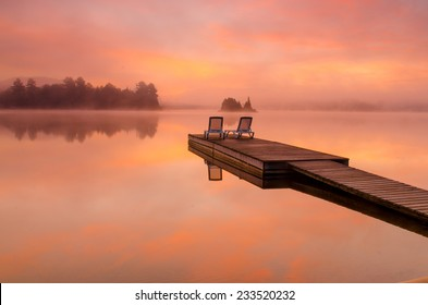 Peaceful scene by the lake on a beautiful foggy morning
