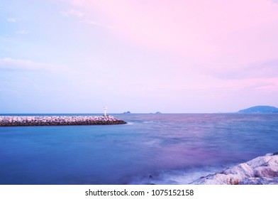A peaceful scene of ocean and cloudy sky pastel colors for you design smooth wavy sea, Long exposure image, Romantic seascape, soft focus.