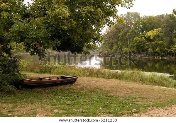 Peaceful scenic view of river and landscape in Summer