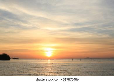 Peaceful  sea sunset , sunrise on the sea with beautiful reflection