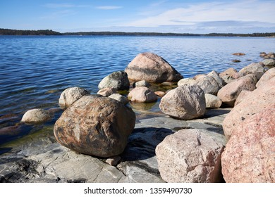 Peaceful summer landscape by the Baltic Sea in Kasnäs, Kemiö, Finland. Wide angle shot of the rocks on the seashore in the Finnish archipelago.