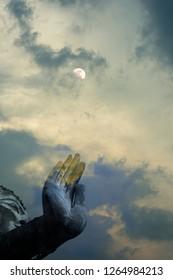 A peaceful superimposed or double exposure images of Sukhothai Buddha statue from Sukhothai Historical Park, Sukhothai, Thailand and beautiful clouds from Bangkok horizontal evening.