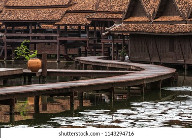 Peaceful thai floating architecture with traditional wooden house and bridge in Ancient City, Thailand, Asia