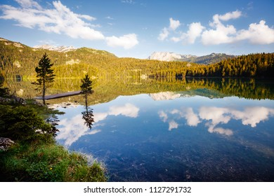 Peaceful view of Black lake. Location National park Durmitor, village Zabljak, Montenegro, Balkans, Europe. Scenic image of travel destination. Wallpaper summer vacation. Discover the beauty of earth.