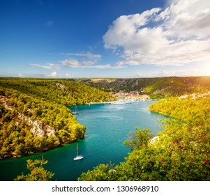 Peaceful view of the canyon Krka river in a beautiful summer day. Location place Krka National Park, Skradin town, Croatia, Europe. Scenic image of tourist destination. Discover the beauty of earth.