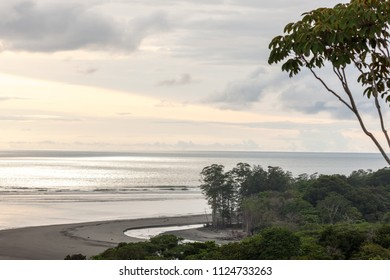 peaceful view of the horizon stretching across the pacific ocean in Costa Rica as the sky begins to change into pastel colors with the setting sun