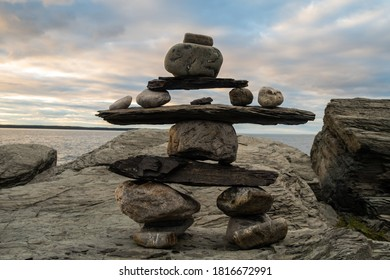 peaceful-view-inukshuk-on-rock-260nw-181