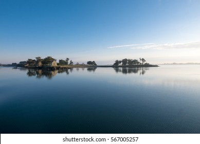 Peaceful view of the Island of Arz with flat calm see in Brittany (Morbihan), France.