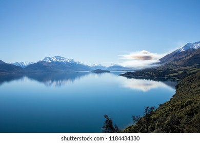 Peaceful view of scenic lake with mountains in the background