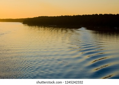 Peaceful Water with Orange Sky