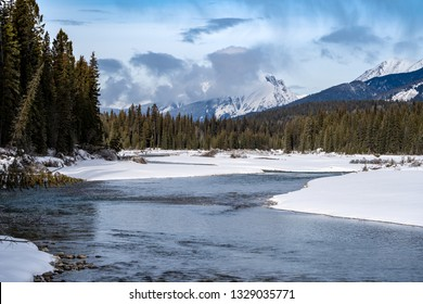Peaceful winter scene along the Kootenay River in Kootenay National Park British Columbia. Pillows of snow along the riverbaks