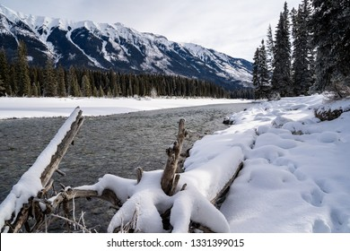 Peaceful winter scene along the Kootenay River in Kootenay National Park British Columbia. Pillows of snow along the riverbanks