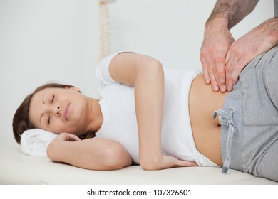 Peaceful woman being massaged by her practitioner in a room