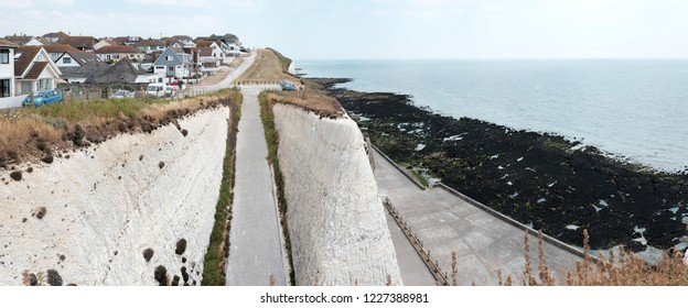 PEACEHAVEN, ENGLAND - JULY 8, 2018: Panoramic view of Friars Bay from the Chalk Cliff in Peacehaven, UK. The bay is part of the natural chalk cliff formation.